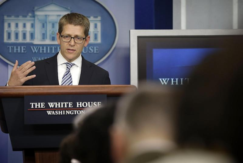 White House Press Secretary Jay Carney gestures as he speaks during his daily news briefing at the White House in Washington, Monday, May, 20, 2013. Carney spoke on various subjects including the recent scandals involving the IRS and Justice Department. (AP Photo/Pablo Martinez Monsivais)
