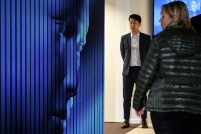 """Concerns over """"deepfake"""" technology which can create credible-appearing false videos have been growing with the rise of artificial intelligence (AFP Photo/Fabrice COFFRINI)"""