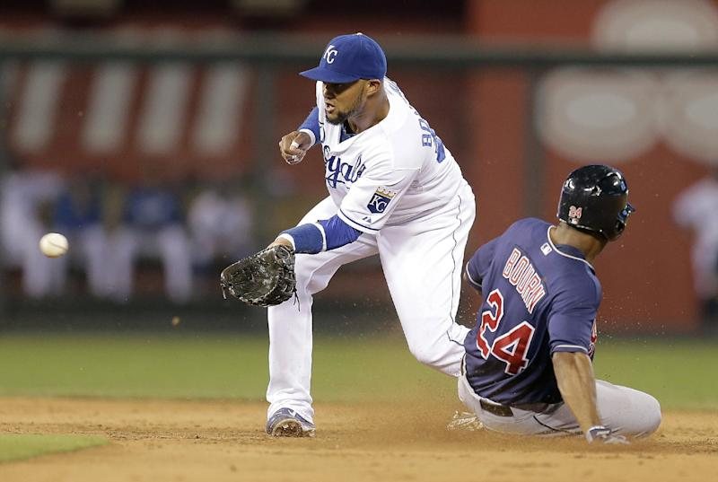 Cleveland Indians' Michael Bourn (24) steals second base before Kansas City Royals second baseman can tag him out during the sixth inning of a baseball game Wednesday, Sept. 18, 2013, in Kansas City, Mo. (AP Photo/Charlie Riedel)