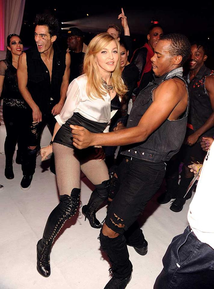 You go girl! A 53-year-old Madonna proved she can still rock the dance floor when she boogied with a fellow named Lil Buck, the winner of the Smirnoff Nightlife Exchange Project dance competition, at New York's Roseland Ballroom on Saturday. And how 'bout those legs! (11/12/2011)