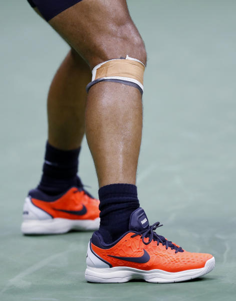 Rafael Nadal of Spain right knee is taped during a match against Juan Martin del Potro of Argentina during the semifinals of the U.S. Open tennis tournament Friday Sept. 7 2018 in New York. Nadal retired from the match