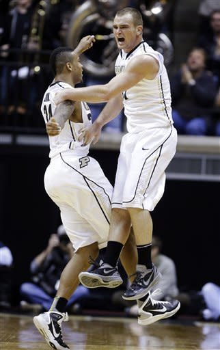 Purdue forward D.J. Byrd, right, celebrates with forward Jacob Lawson after hitting a 3-pointer against Illinois in the second half of an NCAA college basketball game in West Lafayette, Ind., Wednesday, Jan. 2, 2013. Purdue won 68-61. (AP Photo/Michael Conroy)