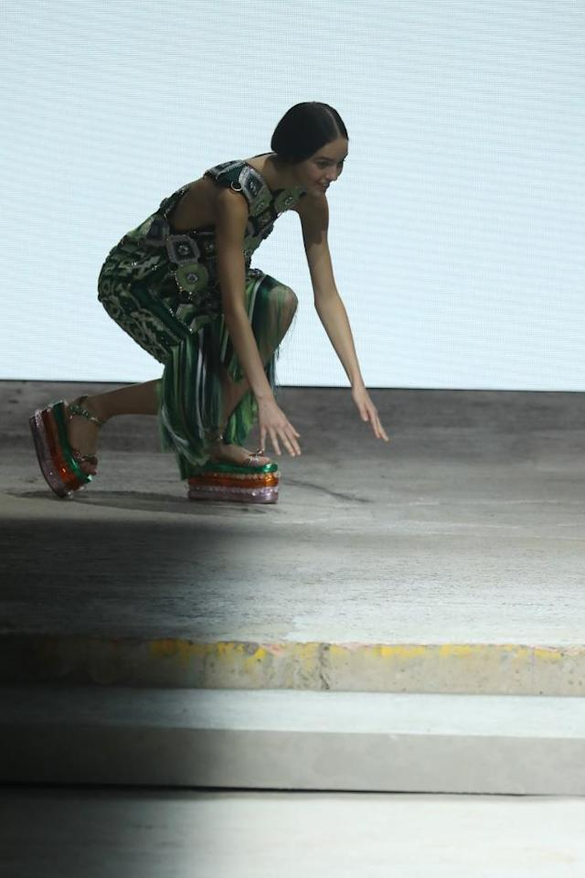 <p>The three tiered platforms at Mary Katrantzou seemed to be a bit of a struggle to walk in as one model took a bit of a tumble.<em> [Photo: Sunday Times Style/ Twitter]</em> </p>