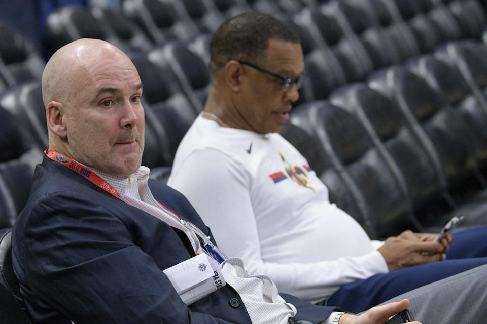 FILE - In this Feb. 23, 2019, file photo, New Orleans Pelicans interim general manager Danny Ferry, left, and coach Alvin Gentry watch players warm up for the team's NBA basketball game against the Los Angeles Lakers in New Orleans. A person familiar with the process says the Pelicans have begun interviewing candidates to become the club's new general manager. The person says the list of candidates includes Ferry, as well as former Cleveland Cavaliers general manager David Griffin, Golden State assistant GM Larry Harris, Brooklyn Nets assistant GM Trajan Langon, Houston Rockets assistant GM Gersson Rosas and interim Washington president of basketball operations Tommy Sheppard. (AP Photo/Matthew Hinton, File)