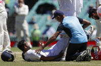 India's Hanuma Vihari receives treatment to a leg injury during play on the final day of the third cricket test between India and Australia at the Sydney Cricket Ground, Sydney, Australia, Monday, Jan. 11, 2021. (AP Photo/Rick Rycroft)
