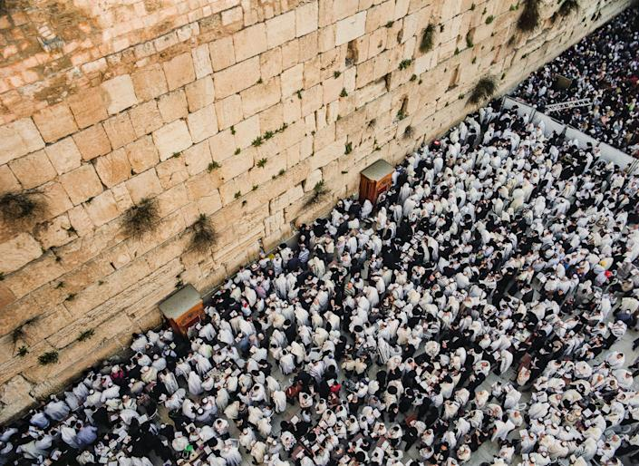"Tens of thousands of Jewish pilgrims congregate at the Western Wall during Passover for the Birkat Kohanim, meaning ""Priestly Blessing""."