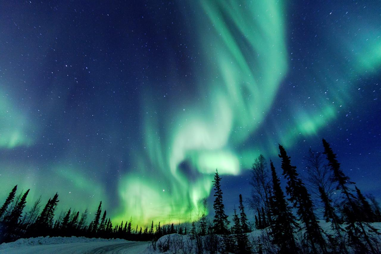 "One of the <a href=""https://www.cntraveler.com/stories/2011-11-07/best-places-to-stay-to-see-the-northern-lights?mbid=synd_yahoo_rss"" target=""_blank"">best places to see the Northern Lights</a>, <a href=""https://www.cntraveler.com/galleries/2015-10-09/northern-lights-in-yellowknife-canada?mbid=synd_yahoo_rss"" target=""_blank"">Yellowknife</a> in Canada's <a href=""https://www.cntraveler.com/story/canadian-road-trip-3-days-on-the-inuvik-tuktoyaktuk-highway?mbid=synd_yahoo_rss"" target=""_blank"">Northwest Territories</a> has a deep blue sky, which sets off the neon colors of the auroras. Want to see it IRL? Visit between mid-November and the beginning of April, when the nights are longest, and during a new moon, for the best chance to catch the natural phenomenon."