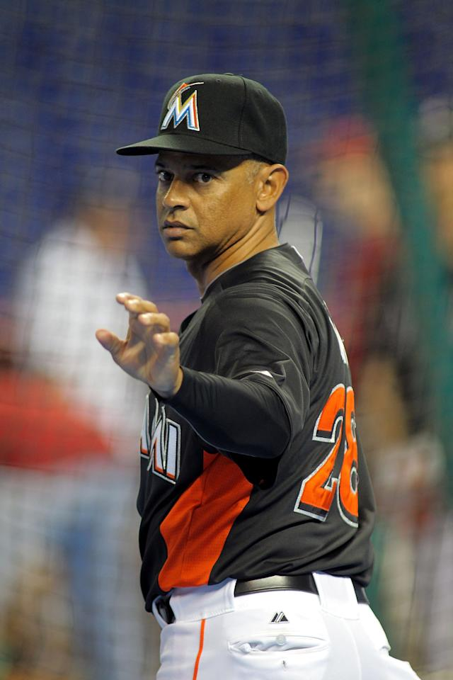 MIAMI, FL - APRIL 13:  Interim Manager Joey Cora #28 conducts batting practice against the Houston Astros at Marlins Park on April 13, 2012 in Miami, Florida.  (Photo by Marc Serota/Getty Images)