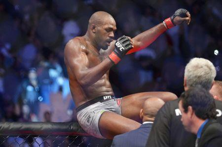 Dec 29, 2018; Los Angeles, CA, USA; Jon Jones (red gloves) after his victory over Alexander Gustafsson (blue gloves) during UFC 232 at The Forum. Mandatory Credit: Gary A. Vasquez-USA TODAY Sports
