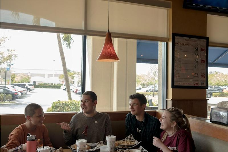 Emma González, Alex Wind, Cameron Kasky and Jaclyn Corin dine at Pasquales in Coral Springs near Parkland on March 6.