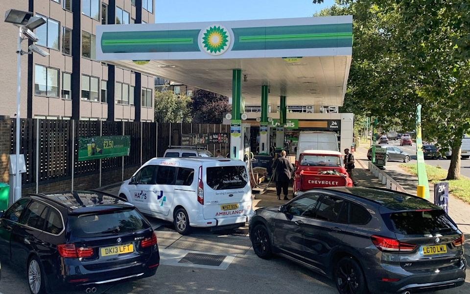 Cars queue at a BP petrol station in west London on Friday