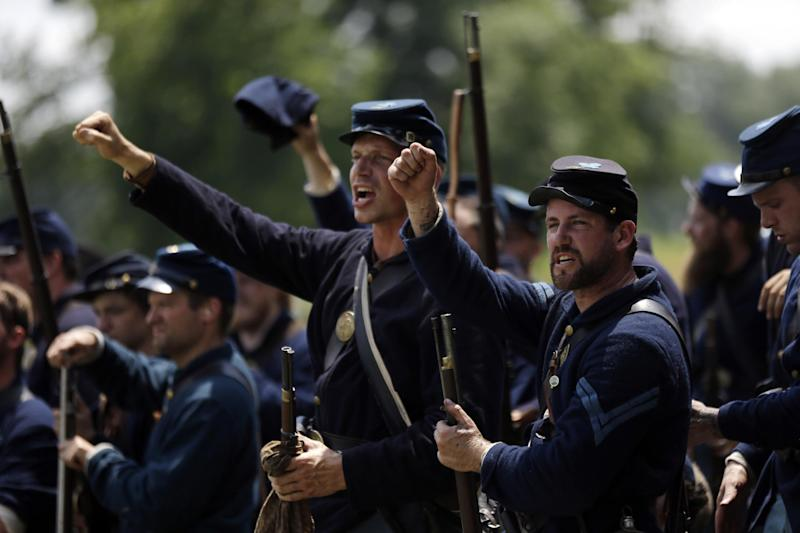 "Re-enactors chant ""Fredericksburg"" as they take part in a demonstration of Pickett's Charge during ongoing activities commemorating the 150th anniversary of the Battle of Gettysburg, Sunday, June 30, 2013, at Bushey Farm in Gettysburg, Pa. Union forces turned away a Confederate advance in the pivotal battle of the Civil War fought July 1-3, 1863, which was also the war's bloodiest conflict with more than 51,000 casualties. (AP Photo/Matt Rourke)"