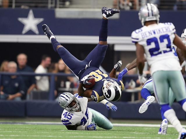 <p>Los Angeles Rams receiver Pharoh Cooper (10) in upended on a kick-off return by Dallas Cowboys fullback Rod Smith (45) at AT&T Stadium. Mandatory Credit: Matthew Emmons-USA TODAY Sports </p>