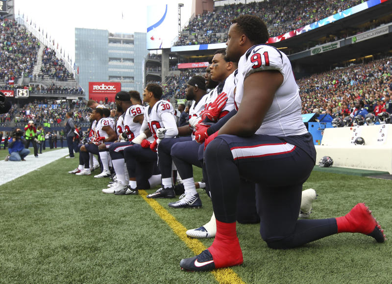 Texans player Carlos Watkins is pictured kneeling with his teammates on Sunday.  (Jonathan Ferrey via Getty Images)