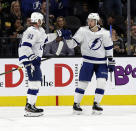 Tampa Bay Lightning forward Steven Stamkos (91) celebrates with forward Anthony Cirelli (71) after scoring during the second period of an NHL hockey game against the Vegas Golden Knights on Thursday, Feb. 20, 2020, in Las Vegas. (AP Photo/Isaac Brekken)
