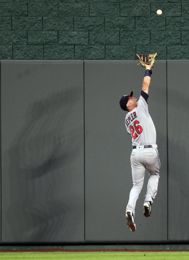 Minnesota Twins center fielder Max Kepler catches a fly ball hit by Kansas City Royals' Rosell Herrera during the fourth inning of a baseball game at Kauffman Stadium in Kansas City, Mo., Friday, July 20, 2018. (AP Photo/Orlin Wagner)