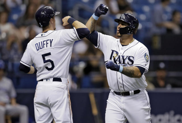 Tampa Bay Rays' Wilson Ramos, right, celebrates with Matt Duffy (5) after Ramos hit a two-run home run off Toronto Blue Jays starting pitcher Jaime Garcia during the third inning of a baseball game Tuesday, June 12, 2018, in St. Petersburg, Fla. (AP Photo/Chris O'Meara)