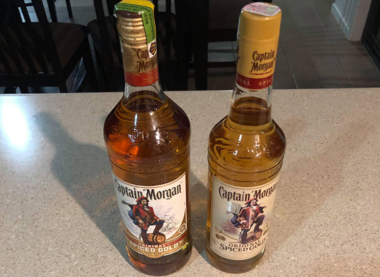 The photo shows a genuine bottle of Captain Morgan on the left and a bootleg version on the right purchased in Bali. The bottles are almost identical.