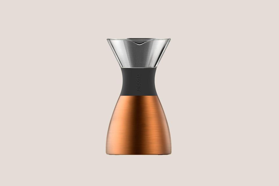 """<p>A great cup of coffee adds a bit of magic to any morning, and with this <a href=""""https://www.marthastewart.com/7846613/coffee-makers-explained-french-press-drip-pour-over"""" rel=""""nofollow noopener"""" target=""""_blank"""" data-ylk=""""slk:pour-over coffee maker"""" class=""""link rapid-noclick-resp"""">pour-over coffee maker</a>, there's no need for paper filters. There's also a removable, insulated portable carafe, so the freshly-brewed coffee will stay hot when taken on errands or a hike.</p> <p><strong><em>Shop Now: </em></strong><em>Asobu Pour Over Coffee Maker, $50, <a href=""""https://www.amazon.com/Copper-Insulated-Coffee-Double-Wall-Stainless-Steel/dp/B07FKHYD6Z/ref=as_li_ss_tl?ie=UTF8&linkCode=ll1&tag=mslggforsustainablecooksbshirvelloct20-20&linkId=a9fc623f38f1f0a21e3eae11ff87a9b3&language=en_US"""" rel=""""nofollow noopener"""" target=""""_blank"""" data-ylk=""""slk:amazon.com"""" class=""""link rapid-noclick-resp"""">amazon.com</a></em><em>.</em></p>"""