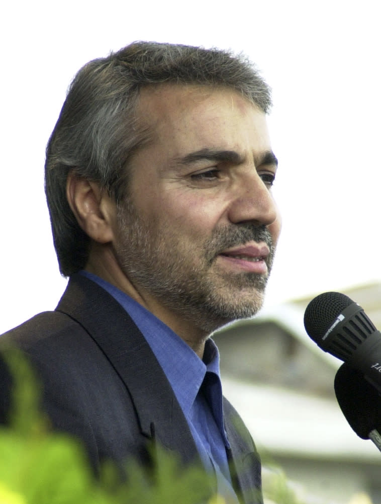 In this photo taken on Monday, Sept. 30, 2002, Mohammad Bagher Nobakht speaks at a meeting in the city of Rasht, Iran. Nobakht, who was spokesman of campaign office of President elect Hasan Rouhani is a potential candidate for economic roles in new cabinet. (AP Photo/Vahid Salemi)