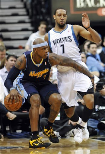 Denver Nuggets' Al Harrington, left, works his way around Minnesota Timberwolves' Derrick Williams in the first half of an NBA basketball game Sunday, March 25, 2012, in Minneapolis. (AP Photo/ Jim Mone)