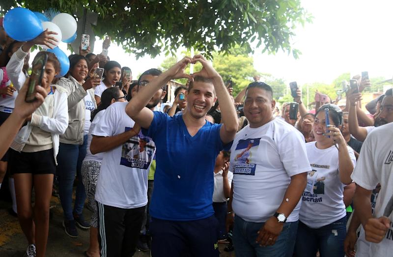Student leader Edwin Carcache (C) celebrates after being released from prison in Managua, Nicaragua, on June 11, 2019 (AFP Photo/Maynor VALENZUELA)
