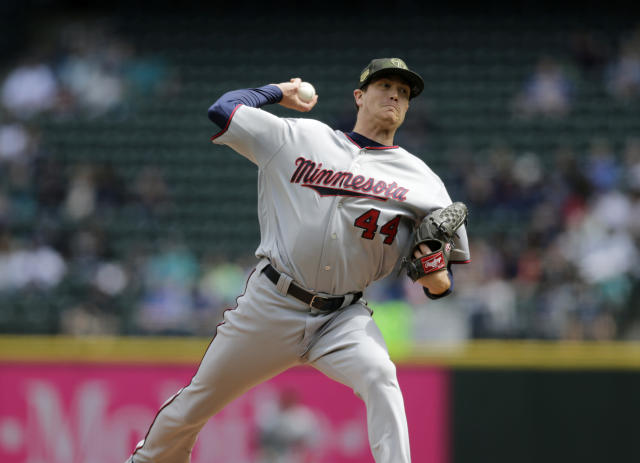 Minnesota Twins starting pitcher Kyle Gibson works against the Seattle Mariners during the first inning of a baseball game, Sunday, May 19, 2019, in Seattle. (AP Photo/John Froschauer)