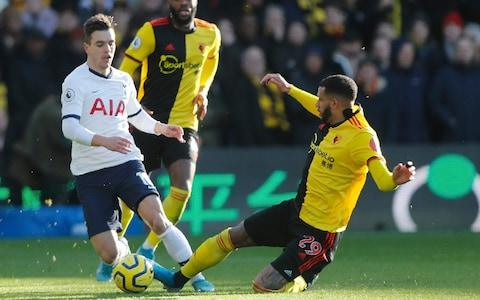 Tottenham's Giovani Lo Celso, left, is tailed by Watford's Etienne Capoue during the English Premier League soccer match between Watford and Tottenham Hotspur - Credit: AP