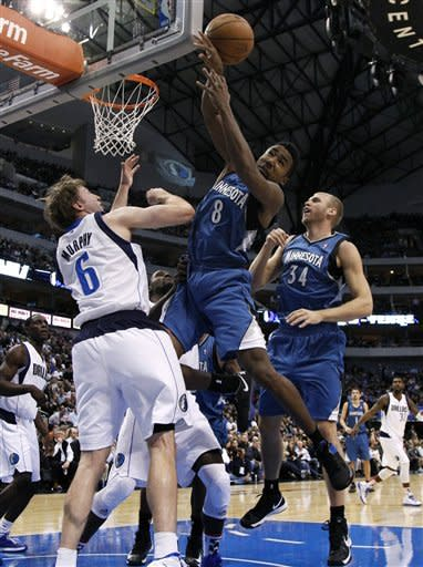 Dallas Mavericks' Troy Murphy (6) breaks up a shot attempt by Minnesota Timberwolves' Malcolm Lee (8) as Greg Stiemsma (34) watches during the first half of an NBA basketball game, Monday, Nov. 12, 2012, in Dallas. (AP Photo/Tony Gutierrez)