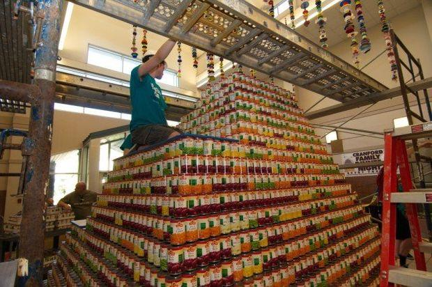 A student on the pyramid of cans (Jim Occi/NJ.com)