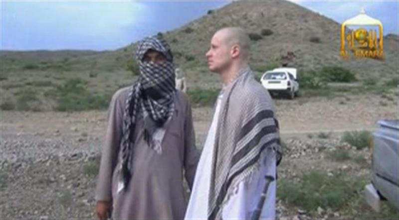 U.S. Army Sergeant Bowe Bergdahl waits before being released at the Afghan border