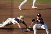 Notre Dame's Jared Miller, left, stretches as he leaps back to first base while Mississippi State first baseman Luke Hancock, right, waits for the throw during an NCAA college baseball super regional game, Monday, June 14, 2021, in Starkville, Miss. (AP Photo/Rogelio V. Solis)