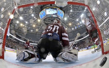 Latvia's goalie Gudlevskis reacts after a goal of the U.S. during their men's ice hockey World Championship Group B game at Minsk Arena in Minsk