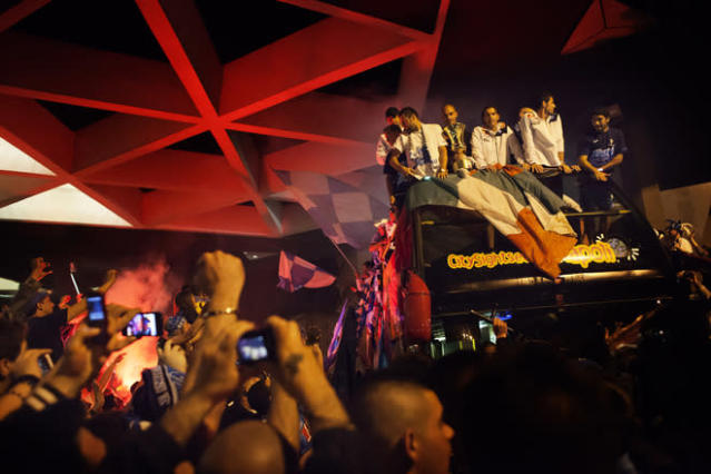 Napoli's football players ride on a double bus as their fans celebrate their victory against Juventus in Naples on May 21, 2012. S.S.C. Juventus' record-breaking 43-match undefeated run came to an end when Napoli won the Italian Cup 2-0. AFP PHOTO/ ANDREA BALDOANDREA BALDO/AFP/GettyImages