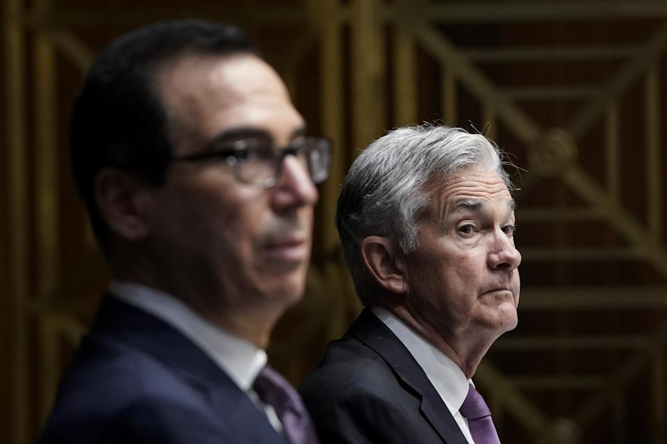 US Secretary of the Treasury Steven Mnuchin and Federal Reserve Board Chairman Jerome Powell(R) testifiy during the Senate's Committee on Banking, Housing, and Urban Affairs hearing examining the quarterly CARES Act report to Congress on September 24, 2020, in Washington, DC. (Photo by Drew Angerer / POOL / AFP) (Photo by DREW ANGERER/POOL/AFP via Getty Images)