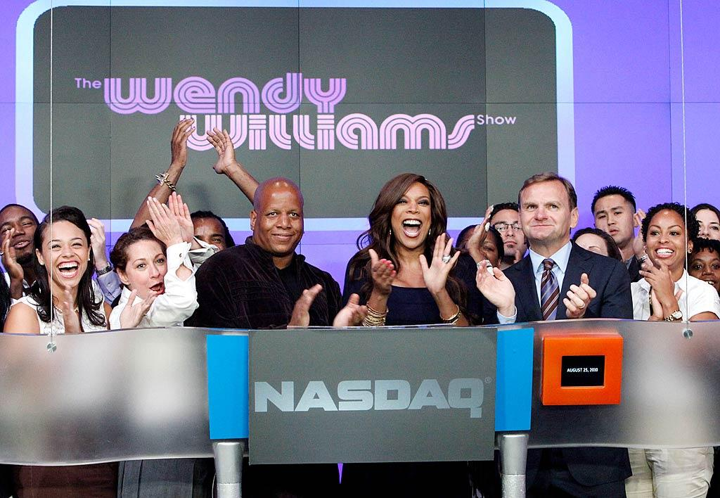 "Ding ding! Daytime talk show diva Wendy Williams had the honor of ringing the opening bell at the NASDAQ MarketSite in New York City Wednesday. ""Me and my staff opening the NASDAQ this morning. How u doin'?"" tweeted the star before commencing trading for the day. John Lamparski/<a href=""http://www.wireimage.com"" target=""new"">WireImage.com</a> - August 25, 2010"