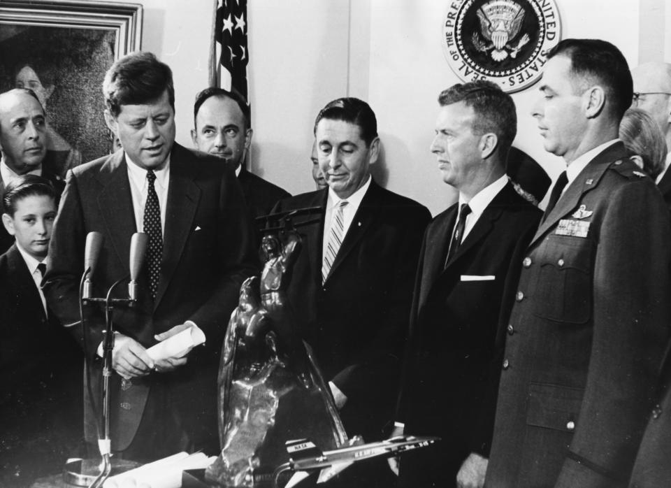 President John F Kennedy meeting a group of X-15 pilots; (L-R) A Scott Crossfield, Joseph A Walker and Major Robert M White, with the Harmon Trophy Award in Washington DC, December 1st 1961. (Photo by Keystone/Hulton Archive/Getty Images)