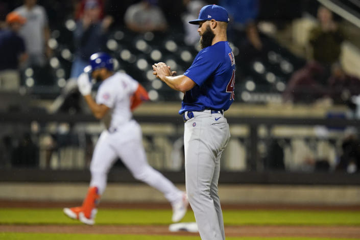 Chicago Cubs starting pitcher Jake Arrieta, foreground, reacts as New York Mets' Dominic Smith runs the bases after hitting a home run during the fifth inning of a baseball game Monday, June 14, 2021, in New York. (AP Photo/Frank Franklin II)