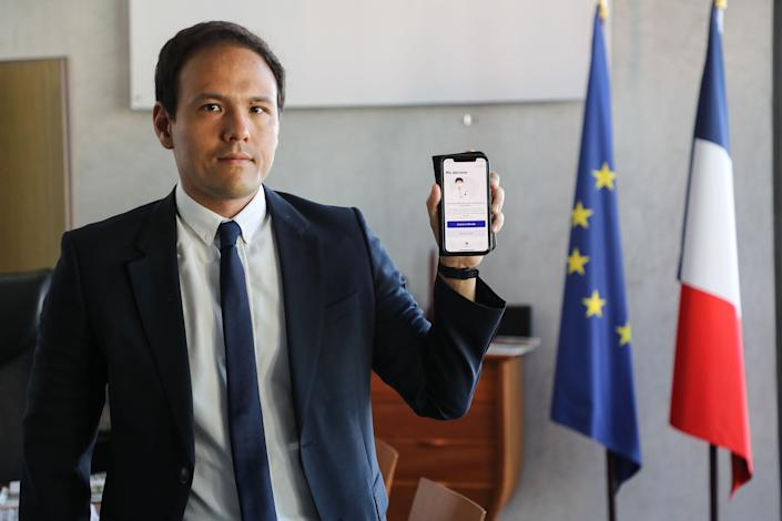 Cedric O, France's junior minister for digital affairs, presents the StopCovid contact tracing app at his office in Paris on May 29, 2020. (Photo: LUDOVIC MARIN via Getty Images)