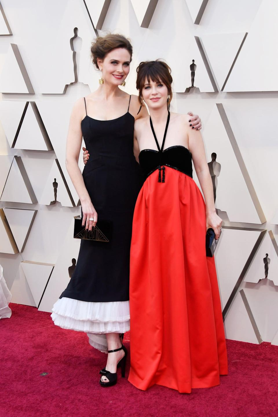 <p>Emily is wearing a vintage 1996 Dior dress with Neil Lane jewels, and Zooey is wearing a colorblock halter-style dress.</p>
