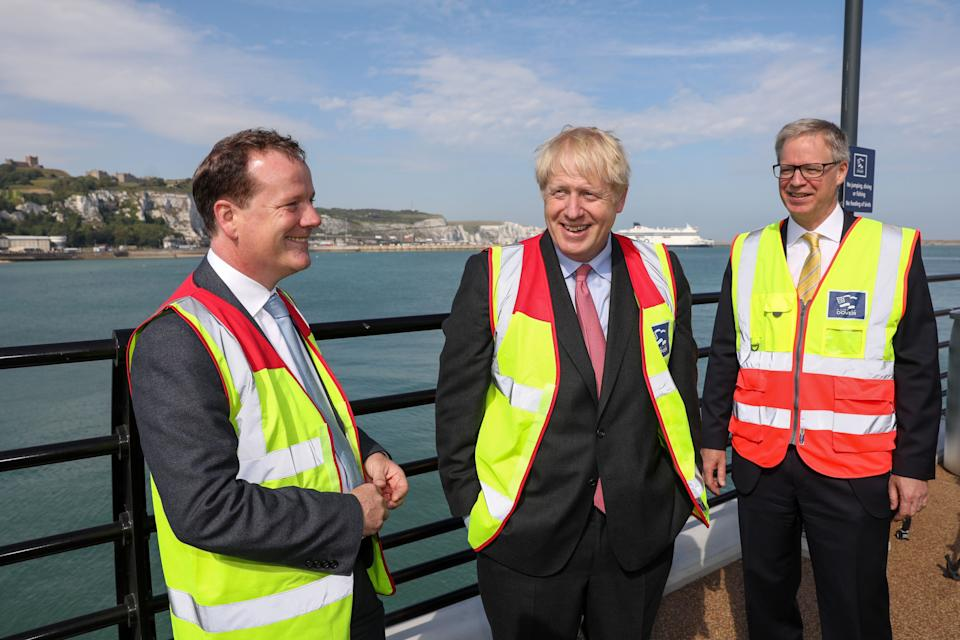 Conservative MP and leadership contender Boris Johnson (C) speaks with Dover's Conservative MP, Charlie Elphicke (L) and Doug Bannister (R), chief executive officer of Port of Dover Ltd. during a visit to the Port of Dover Ltd. during his Conservative Party leadership campaign tour, in Dover, on the southern coast of England on July 11, 2019. - Britain's leadership contest is taking the two contenders on a month-long nationwide tour where they will each attempt to reach out to grassroots Conservatives in their bid to become prime minister. (Photo by Chris Ratcliffe / POOL / AFP)        (Photo credit should read CHRIS RATCLIFFE/AFP via Getty Images)