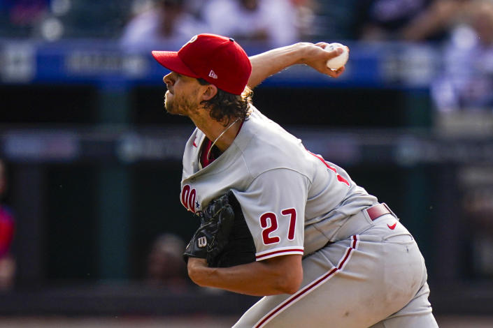 Philadelphia Phillies' Aaron Nola delivers a pitch during the sixth inning of the first baseball game of a doubleheader against the New York Mets, Friday, June 25, 2021, in New York. (AP Photo/Frank Franklin II)