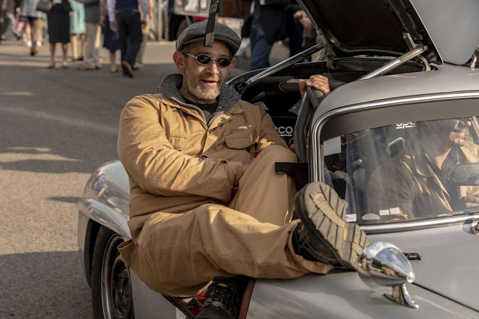"""<p>And talk about period correct: when's the last time you saw anyone rest a boot on the fender of a <a href=""""https://www.caranddriver.com/features/a15112365/go-go-gullwing-a-modern-review-of-the-mercedes-benz-300sl-feature/"""" rel=""""nofollow noopener"""" target=""""_blank"""" data-ylk=""""slk:1955 Mercedes-Benz 300SL"""" class=""""link rapid-noclick-resp"""">1955 Mercedes-Benz 300SL</a>?</p>"""