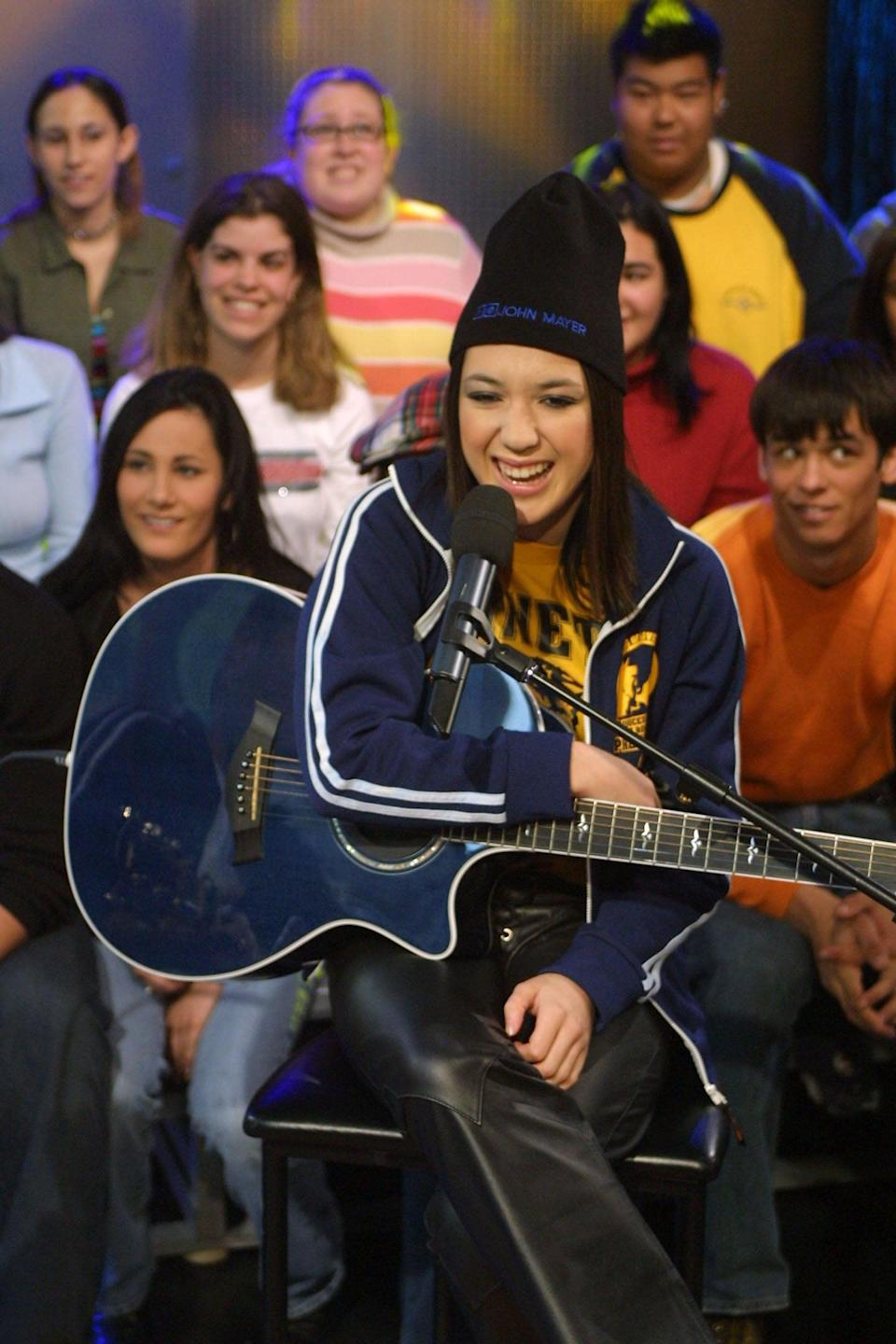 <p>Michelle Branch gave Carson Daly a guitar lesson on <b>TRL</b> in 2002.</p>