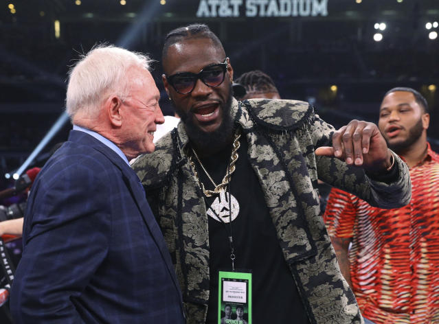 Dallas Cowboys owner Jerry Jones talks with boxer Deontay Wilder before the IBF welterweight championship boxing bout between Errol Spence Jr. and Mikey Garcia on Saturday, March 16, 2019, in Arlington, Texas. (AP Photo/Richard W. Rodriguez)