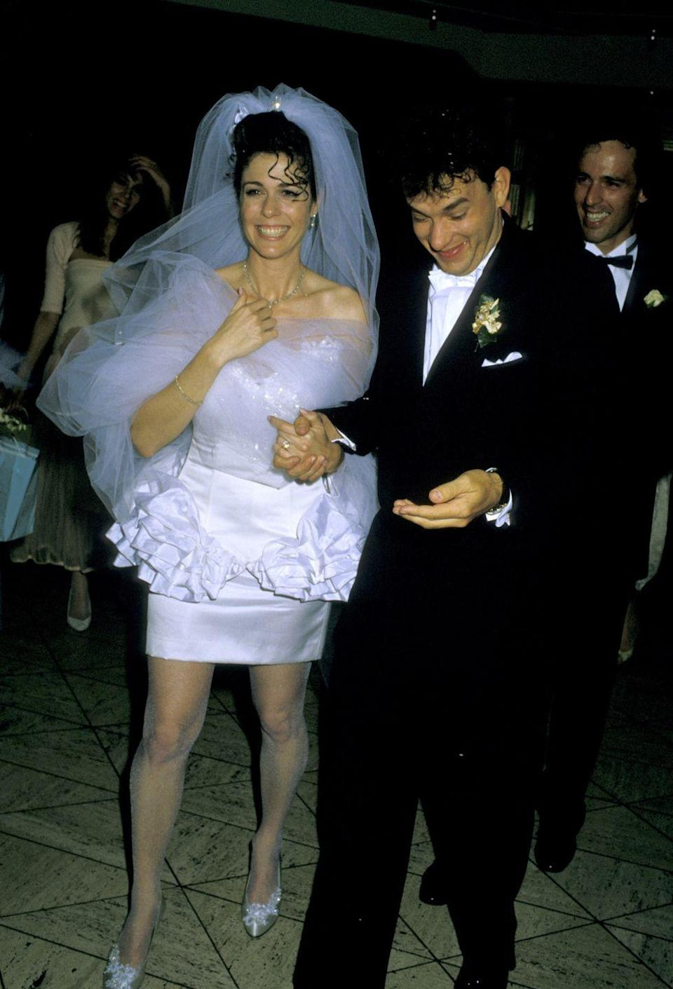 """<p>Rita Wilson and Tom Hanks can barely contain their excitement after their Las Vegas nuptials in 1988. The couple met as costars in the 1984 film <em>Volunteers</em> and <a href=""""https://www.goodhousekeeping.com/life/entertainment/g3131/tom-hanks-rita-wilson-marriage"""" rel=""""nofollow noopener"""" target=""""_blank"""" data-ylk=""""slk:noticed an immediate spark"""" class=""""link rapid-noclick-resp"""">noticed an immediate spark</a>.</p>"""