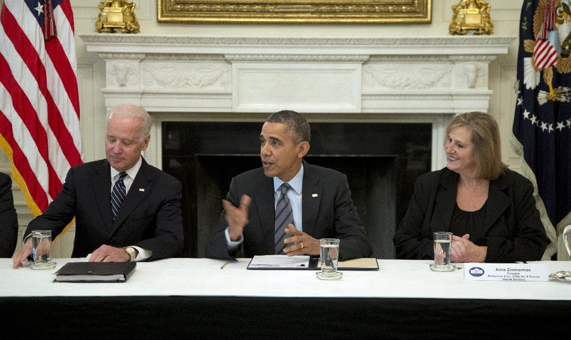 President Barack Obama, flanked by Vice President Joe Biden, left, and Anne Zimmerman, President, Zimmerman & Co., CPAs, Inc. & Zimcom Internet Solutions, right, speaks during a photo opportunity as he meets with a group of business leaders in the State Dining Room of the White House, Friday, Jan. 31, 2014, in Washington., to discuss practices for hiring the long-term unemployed. (AP Photo/Carolyn Kaster)
