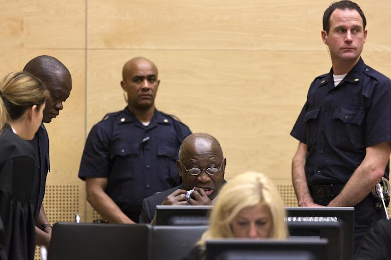 Former Ivory Coast President Laurent Gbagbo, back row center, attends a confirmation of charges hearing at the International Criminal Court (ICC) in The Hague, Netherlands, Tuesday Feb. 19, 2013. ICC prosecutors will begin laying out a summary of their evidence to allow judges to decide if it is strong enough to merit putting Gbagbo on trial for crimes against humanity allegedly committed after disputed 2010 presidential elections. (AP Photo/Michael Kooren, Pool)