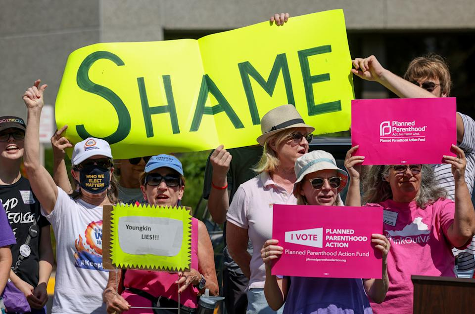 Demostrators protest outside of a campaign event for Virginia gubernatorial candidate Glenn Youngkin (R-VA), in McLean, Virginia, U.S., July 14, 2021. (Evelyn Hockstein/Reuters)