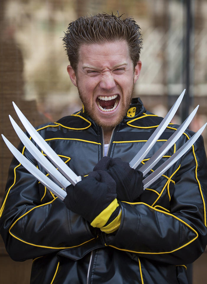 Cosplayer Tom Roy poses while dressed as comic book character Wolverine during the 2013 San Diego Comic-Con (SDCC) International in San Diego, California July 18, 2013. REUTERS/Fred Greaves (UNITED STATES - Tags: ENTERTAINMENT SOCIETY)
